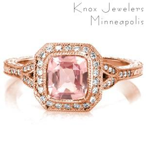 Custom split shank rose gold engagement ring in Atlanta. A unique radiant halo around a pink cushion cut sapphire center stone are the perfect focal point for the rose gold's warm hues.