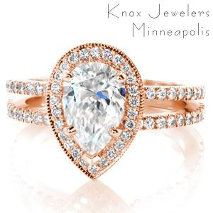 Rose gold engagement ring in Cleveland with pear shape center stone, split shank and diamond halo.