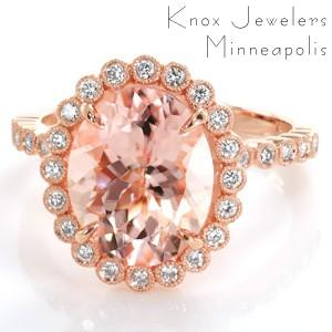 Design 3455 is an effervescently modern take on a halo engagement ring design. The diamond halo, basket, and band are all formed of small round brilliant diamonds in tiny bezel settings with milgrain. The 3.20 carat oval morganite center stone is a perfect color compliment to the warm peachy pink hue of the rose gold.