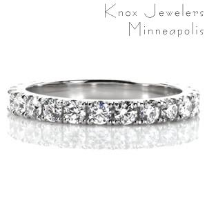 Featuring 2.20 millimeter diameter round brilliant diamonds, Design 3457 is a stunning wedding band or anniversary ring design. The gems are held in hand formed U-cut settings; a French pavé setting style. This creates an elegant scalloped view from the sides, while maximizing the sparkle from the stones!