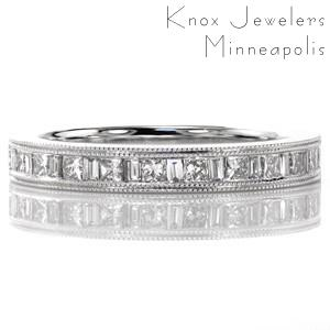 Design 3458 is a stylish band with the luster of 14k white gold and diamonds. The alternating princess and baguette stones create a captivating effect with the brilliant and step cuts. A double row of milgrain frame the diamonds adding texture and depth to the edges of the band.