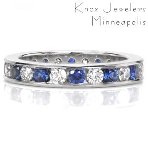 Design 3461 is mesmerizing with the sequence of natural blue sapphires and sparkling white diamonds in a continuous pattern. The sleek channel setting securely fashions each stone in an eternity span. A high polish finish is applied to the surface of the ring.