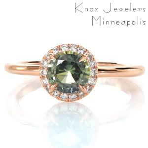 Unique rose gold and green sapphire halo engagement ring in Portland. High polished rose gold band adds luster to the sparkle of the diamond halo.
