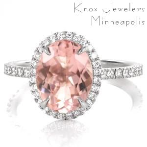 Micro pavé diamonds outline the shape of the 2.00 carat oval gemstone. The brilliance of the diamonds enhance the beauty of the soft pink hue of the morganite center. Throughout the setting hand crafted u-cut prongs allow more light to reach the surface of diamonds for added shine and radiance.