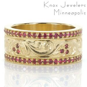 Our Design 3468 took inspiration from another of our custom creations and re-imaged this intricate band in gorgeous color. The wide band ring features hand engraving in a scroll pattern, scattered with floral shaped bead set rubies. Vibrant rubies also frame with central design in bead set rails.