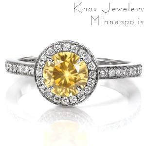 Custom sapphire engagement rings in Portland. This beautiful yellow sapphire is surrounded by a two-sided micro pave diamond halo, and a micro pave band.