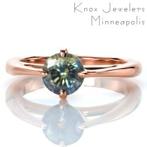 Custom engagement ring in El Paso with bluish green sapphire in a rose gold setting.