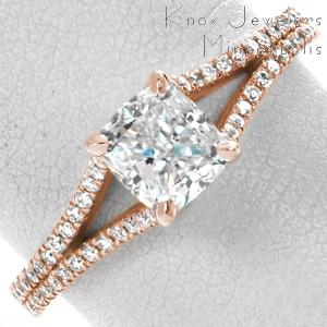 Houston rose gold wedding ring with cushion center stone and split-shank diamond band.