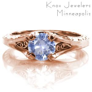 Antique engagement ring in Henderson with filigree, hand engraving and blue sapphire center stone.