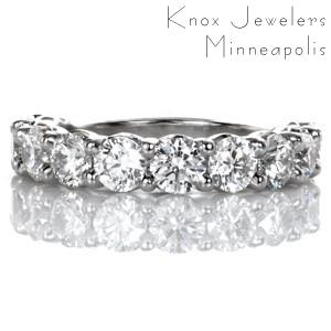 Design 3483 is a perfect statement band with .25 carat brilliant cut round diamonds forming a dazzling arc. This regal design features elegant, scalloped shared-prong settings. Great as a wedding band, anniversary piece, or part of a show stopping stacking-set.