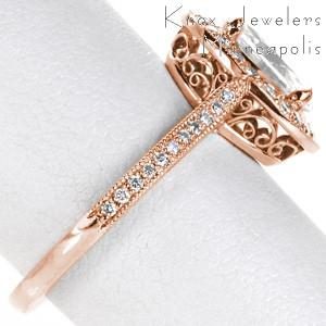 Richmond rose gold engagement ring with filigree, micro pave diamonds and oval center stone.