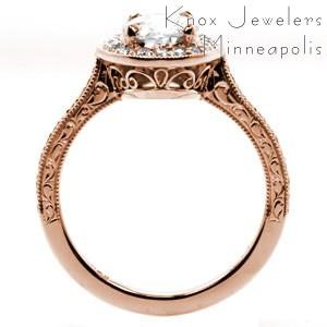 Massachusetts rose gold engagement ring with oval center stone, hand engraving and filigree.