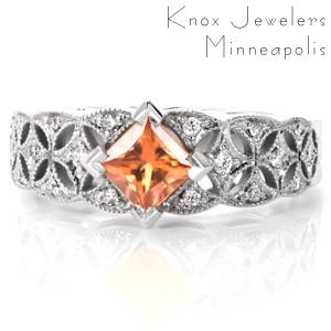 Unique orange princess cut sapphire engagement ring is a stunning choice in Austin, Texas. The kite-set princess cut sapphire is the perfect accent to the beautiful micro pave star bursts.