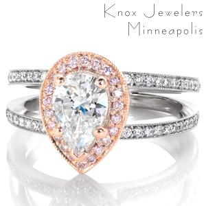 Stunning custom rose gold engagement ring in Ann Arbor. This two-tone micro pave halo engagement ring features beautiful pink diamonds in a rose gold halo. Micro pave bands complete the look of the rose gold pear engagement ring.