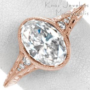Rose gold engagement ring in Ottawa with full milgrain bezel, oval center and antique band.