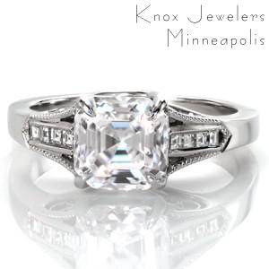 This stunning engagement ring design was inspired by the beauty and romance of Paris, France. An asscher cut diamond is set between dazzling, channel set, carre cut side diamonds while milgrain beading frames the design. The sides feature beautiful hand formed filigree curls and an elegant center setting style.