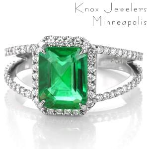 Design 3498 is crafted in 950 Platinum Ruthenium, and presents a stunning 2.20 carat emerald cut center gemstone. The natural Emerald is set within four tapering prongs.  The split shank band and halo have a classic look of  micro pavé with hand set round cut diamonds.