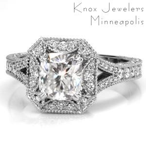 This regal design features a cushion cut center stone surrounded by a unique rectangular halo with clipped corners. The split shank band is adorned with diamonds and milgrain and draws the eye to the magnificent halo. Relief engraving and filigree are created by hand giving Design 3499 an antique appeal.