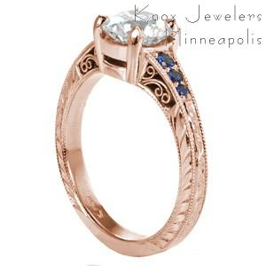 Rose gold engagement ring in Cleveland with blue sapphires, milgrain and round center stone.