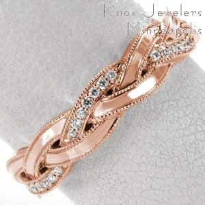 Rose gold wedding ring in Ottawa with single micro pave band braided between two high polished bands.