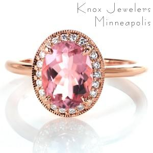 Rose gold engagement ring in Fargo with diamond halo and oval morganite center stone.