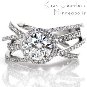 Design 3507 is an extraordinary custom engagement ring combining one of our signature wide bands with a glittering diamond halo. Four diamond bands, differing in settings styles, frame the center 1.50 carat round brilliant diamond held in its halo. Colored surprise stones add the final touch to this custom design!