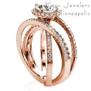 Rose gold wedding ring in Colorado Springs with diamond halo, round center stone and overlapping diamond bands.