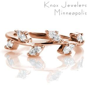 Rose gold stacker ring is a stunning wedding band possibility in Providence. This stacking ring is featured in rose gold with marquise diamonds looking like leaves on a vine ring.