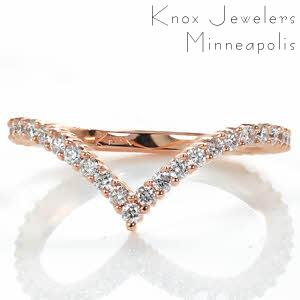 Design 3517 is an extraordinary custom created contemporary diamond band that can be worn alone or paired against any of our custom engagement rings for a modern look. The prong set diamonds arch into a dramatic point with a subtle curve on either side.