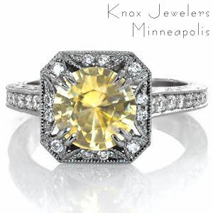 Design 3520 features a dramatic colored center stone to redefine one of our most popular settings. A stunning 2.00 carat round yellow sapphire is surrounded by a scalloped diamond halo and vintage inspired milgrain edging. Hand carved scroll relief engraving adds elegance to the profile view.