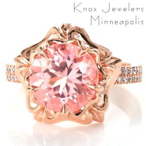 A stunning 3.00 carat round cut rosy pink morganite is featured in our custom Design 3525. This exceptional center stone is surrounded by a distinctive floral shaped halo. It includes a double layer of high polished petals and five claw prongs that blend seamlessly into the design.