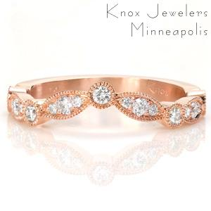 This version of one of our most popular wedding band designs, Slipper, can be custom contoured around any of our engagement ring designs. Milgrain edging and multiple diamond setting styles make this scalloped band an interesting addition to any ring set.
