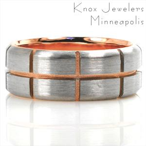 This two-tone wedding band is a stunning mix of texture and color. The lining is shown in high polished 14k rose gold. The outer band is shown in 14k white gold with beveled edges and a brushed finish. The outer layer is carefully separated by even, symmetrical grooves to show off the sand-blasted rose gold in between.