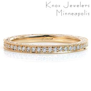 Featuring small round brilliant cut diamonds, this custom eternity style wedding band is a dazzling addition to any wedding set. The beadset style of the diamonds is complimented by the milgrain texture on the edges of the piece. One side of the band is kept high polished to face the engagement ring.