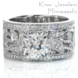 Design 3552 is a detailed organic design featuring beautiful  micro pavé leaves and vines flowing down the sides of the band. This wide band design is shown with a Euro-shank base, and is shown with a cushion cut center stone. The edges of the pattern are all detailed with a beaded milgrain texture.