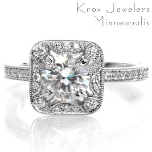 Design 3559 has a stunning, antique inspired halo framing a 0.70 carat round cut center stone set within four double prongs. The halo features softer, rounded corners and half moon contour elements. The halo is slightly uplifted over the diamond set band to allow a perfect match for a future wedding band.