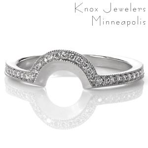 This antique inspired wedding band was originally designed as a matching contoured band for Design 3032. The low profile of the curve allows it to tuck in under the detailed basket of the engagement ring. The beadset micro pavé diamonds edged with beaded milgrain texture perfectly match the vintage styling.