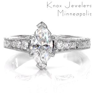 The exquisite combination of bright-cut and relief engraving styles creates a beautiful vintage engagement ring option. Shown with a marquise cut center stone, the flared band compliments the length of the diamond. Hand wrought filigree curls on the sides of the piece, and milgrain edging add to the antique appeal.