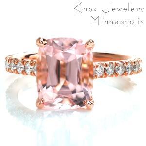 This classic U-cut micro pavé setting style is made modern with the combination of warm hued rose gold and the soft, pale peachy pink morganite center stone. The basket under the center stone is a subtle, elegant detail that compliments the U-cut settings of the side diamonds.