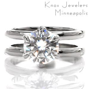 Design 3617 is a contemporary split shank design featuring an elegant, lacy, six-prong center stone setting. The two bands are matching widths and spaced to allow for a wedding band to rest between them. The luster of the high polished ring is a beautiful contrast to the sparkle of the center stone.