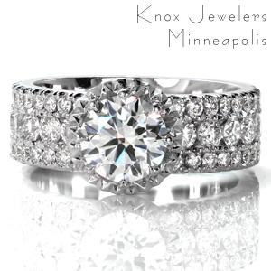 Design 3618 is a beautiful wide band designed with three rows of diamonds. The raised center stone is held in an eight-prong setting. Faceted metal creates a sparkling border around the center stone to mimic a halo. The faux-halo is upraised to allow for a straight wedding band to be worn next to the ring.
