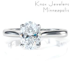 Simple elegance creates the perfect solitaire engagement ring. Featuring a 1.20 carat oval diamond and a tapered band, the center stone is the showstopper of this design! The decorative basket flows into the claw prongs, and the center setting up raised to allow for easy wear with any wedding band.