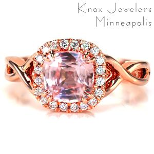 Dazzling prong set diamonds encircle a 1.70 carat cushion shape pink sapphire in Design 3652. Two high polished bands entwine to create a stunning split shank. The open pockets of the band is the perfect compliment to the open gallery under the diamond halo.