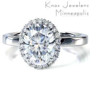 This classic diamond engagement ring design features a delicate halo made up of hand-created U-cut pavé settings. The single width, high polished band offers a contrast to the sparkle of the halo and center stone. This beautiful ring was designed to allow easy pairing with a variety of wedding band styles.