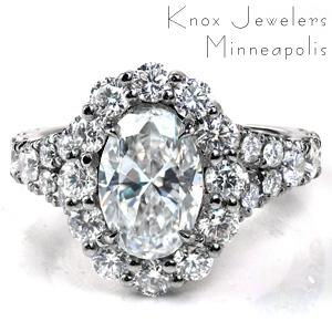 Design 3668 is a split shank design with a a decorative basket under the center halo. The halo and band feature larger side diamonds for a stunning look. The band is set with hand-created U-cut pavé. The decorative basket features tapered rows of diamonds flowing up into the prongs of the halo.
