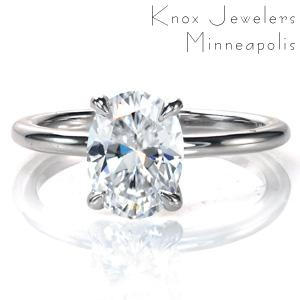 Simple elegance perfectly describes our Oval Petite design. This single-width band is shown with a flowing four prong center setting. The setting is designed to allow for easy wear of a variety of wedding band styles. Currently shown with a 1.00 carat oval, this beautiful ring will be a timeless classic.