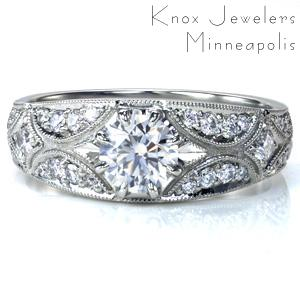 A unique custom ring, Design 3681 features a round brilliant cut center stone in an eight-prong setting. The band tapers slightly and has an alternating pattern of scallops and starbursts, embellished with diamonds and accented with a milgrain outline.