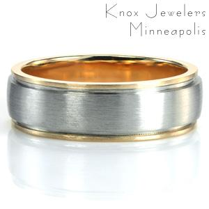 The Seattle Two Tone takes a modern gent's band and gives it more color and warmth.  The long, narrow channel of the double pinstripe groove runs parallel to the edges of the ring, separating the white and yellow gold. A brushed finish attractively adds texture to the surface of the design.