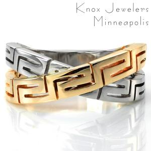 The Greek Key motif took its name from the river Meander in ancient Greece. It became the most important symbol in Ancient Greece, symbolizing infinity or the eternal flow of things. Our Greek Key Ring intertwines two bands of this symbolic pattern in two tones that flow seamlessly from the joined band at the base.