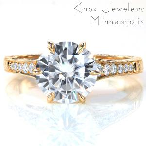 A stunning 1.70 carat center stone is set in a classic 6-prong cathedral setting. The antique inspired band is accented with bright cut hand engraving, milgrain edges, and pockets of hand wrought filigree curls. Surprise diamonds in petal shapes are visible from the sides, while six diamonds adorn the top of the band.